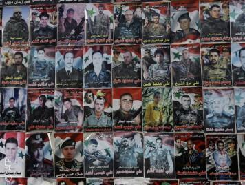 """صور """"الشهيد البطل الملازم شرف"""" تملأ مناطق العلويين في سوريا"""