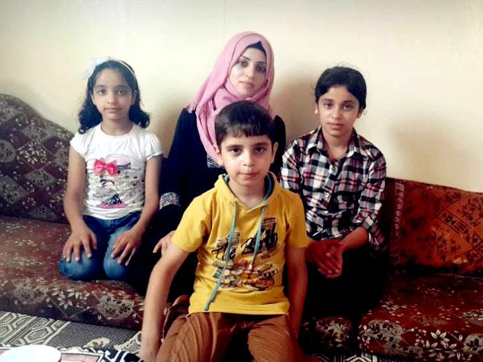أرامل الشهداء في قطاع غزة - وفاء وأطفالها