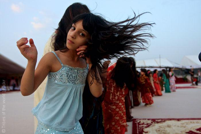 Girls-celebrating,-dancing-in-line,-flicking-hair,-Emirates,-UAE_Tribes-of-the-world_Flickr