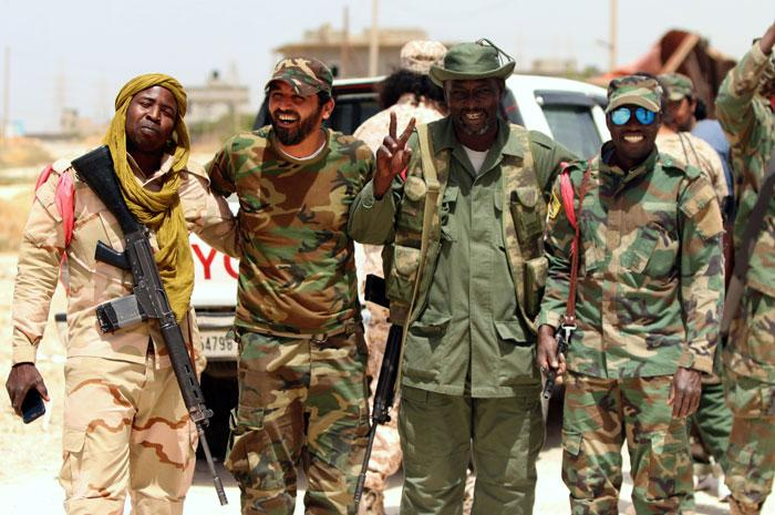 Pro-goverment-forces-patrolling-area-near-Benghazi-fighting-militants_AFP